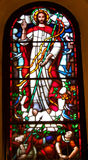 Jesus picture on stained glass in the church Stock Photos