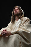 Jesus portrait in prayer. With black background Stock Image