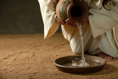 Jesus pouring water royalty free stock photography