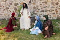 Jesus preaching to the people. Jesus preaching to a group of people - historical reenactment Royalty Free Stock Image