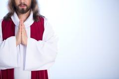 Jesus que une as mãos fotografia de stock