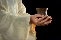 Jesus räcker innehav kuper royaltyfri foto