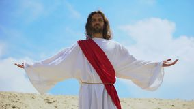 Jesus raising arms to sky, bringing blessing and faith, Christian religion. Stock footage stock footage