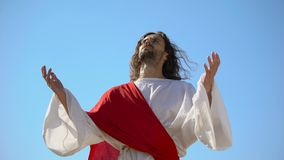 Jesus raising hands to sky and praying, resurrection and ascension of Christ. Stock footage stock footage