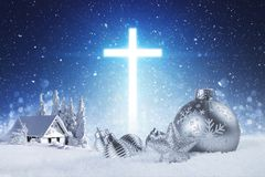 Jesus is the reason for the season. With silver ornaments and a glowing cross in the background Royalty Free Stock Images