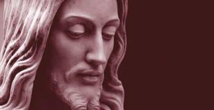 Jesus, red-toned photo  copy-space. Jesus statue close-up, red-toned photo with copy-space Stock Photos