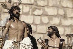 Jesus rev av av hans plagg, påsk i Seville Arkivfoton