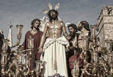 Jesus rev av av hans plagg, påsk i Seville Royaltyfria Foton