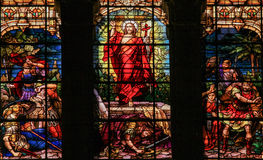 Jesus rising from the grave - Stained Glass. Stained glass window depicting Jesus rising from the grave, located in the cathedral of Malaga, Spain royalty free stock photo