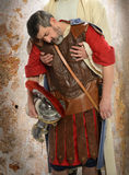 Jesus and Roman Centurion. Jesus holding exhausted Roman Centurion Stock Photography