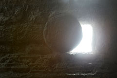 Jesus`s Tomb. Jesus`s empty Tomb seen from the inside with light comming from the outside stock photos