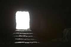 Jesus`s Tomb. Jesus`s empty Tomb seen from the inside with light comming from the outside royalty free stock images
