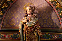 Jesus and the sacred heart. Sculpture of Jesus showing the sacred heart Royalty Free Stock Photography