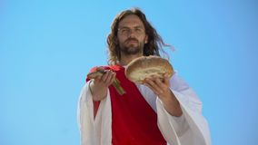Jesus showing fish and bread, biblical story, miracle about feeding thousands. Stock footage stock video footage