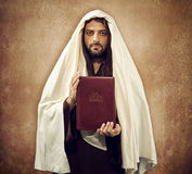 Jesus shows the holy bible Royalty Free Stock Images