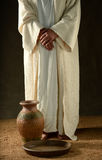Jesus standind with his hands crossed Stock Photo