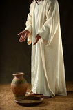 Jesus standing with hands extended Stock Photo