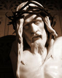 Jesus statue. A statue of crucified Jesus, thorn crown on his head Stock Image