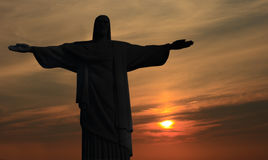 Jesus statue. Statue of Jesus against the setting sun Royalty Free Stock Photos