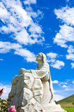 Jesus statue. A statue of Jesus with a blue sky and clouds at a cemetery in Riverside,CA Royalty Free Stock Photo
