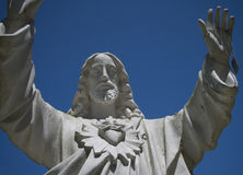 Jesus statue with fallen soldier's ID tag 2 Stock Photo