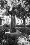 Jesus statue outstretched hands. Statue of Jesus with outstretched arms found in cemetery in St Augustine Florida stock image