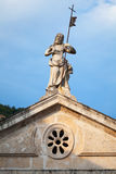 Jesus statue on rooftop of church in Perast Royalty Free Stock Image