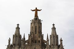 Expiatory Church of the Sacred Heart of Jesus, Tibidabo mountain, Barcelona. Jesus statue on the top of Expiatory Church of the Sacred Heart of Jesus at Tibidabo Royalty Free Stock Images