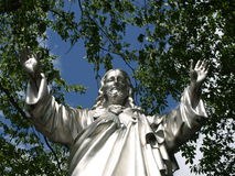 Jesus statue with trees Stock Photography