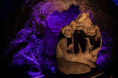 Jesus Stone sculpture front of purple light in the. Stone sculpture of Jesus in front of purple light in the underground salt cathedral Zipaquira near Bogota Stock Photos