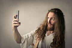Jesus taking a selfie stock image