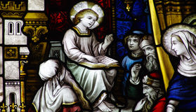 Jesus teaching in the temple stained glass. A photo of Jesus teaching in the temple stained glass royalty free stock photo