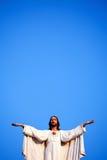 Jesus tegen blauwe hemel royalty-vrije stock fotografie