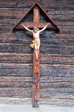 Jesus with a thorn crown hanging on a cross. Sculpture of Jesus with a thorn crown, hanging on a wooden cross Royalty Free Stock Photos