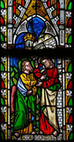 Jesus to Saint Thomas: Stop doubting, but believe. Stained glass window depicting Saint Thomas touching the wound of Jesus, in the Cathedral of Saint Truiden in Royalty Free Stock Images