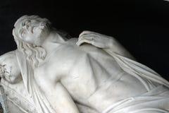 Jesus tomb. Jesus is laid in the Tomb stock photo