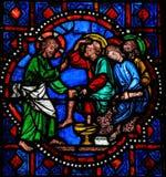 Jesus tvättande fot av St Peter på skärtorsdag - nedfläckat G Arkivbilder