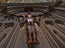 Jesus under the clock. A statue of Jesus sitting under the unique clock in Wells Cathedral Royalty Free Stock Photos