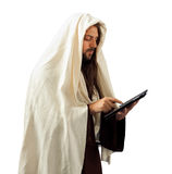 Jesus uses the tablet Stock Image