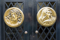 Jesus and Virgin Mary faces carved in metal Stock Image