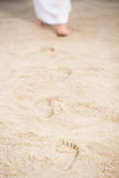 Jesus walking leaving footprints. Jesus walking leaving his footprints in sand Royalty Free Stock Photo