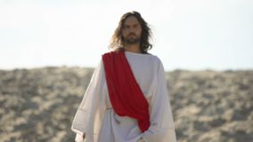 Jesus walking to people, preaching Christian faith in desert, soul salvation. Stock footage stock video