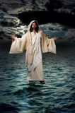 Jesus Walking on the water. During the night with moonlight Stock Image