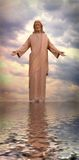 Jesus Walking On Water. With cloudy sunset in background - he reflection seen in the water royalty free stock photography