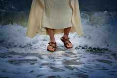 Jesus Walking on the Water. With waves crashing on the surface royalty free stock image