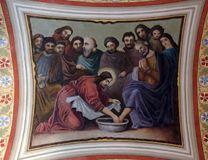 Jesus washes the feet of Peter. Fresco in the church of Saint Matthew in Stitar, Croatia Stock Photos