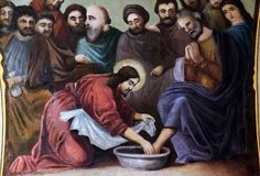 Jesus washes the feet of Peter. Fresco in the church of Saint Matthew in Stitar, Croatia Royalty Free Stock Photo