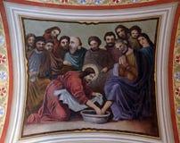 Jesus washes the feet of Peter. Fresco in the church of Saint Matthew in Stitar, Croatia Stock Photo