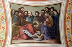 Jesus washes the feet of Peter. Fresco in the church of Saint Matthew in Stitar, Croatia Stock Image