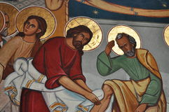 Jesus Washes His Disciples' Feet  PAINTINGS. Jesus Washes His Disciples' Feet - mural paintings in Bistrita Royalty Free Stock Photo